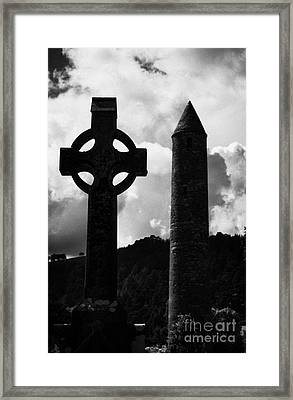 St Kevins Round Tower And Celtic Cross Headstone In Graveyard At Glendalough Monastic Site County Wicklow Ireland Framed Print