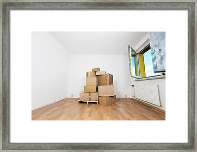 Stack Of Cardboard Boxes In An Empty Room Framed Print by Wladimir Bulgar