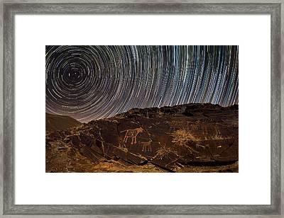 Star Trails Over Rock Carvings Framed Print by Babak Tafreshi