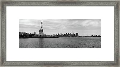 Statue Of Liberty With Manhattan Framed Print by Panoramic Images