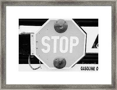 stop sign on a type a gmc north american short yellow school bus Saskatchewan Canada Framed Print