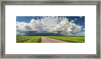 Storm Clouds Over The Prairies Framed Print by Susan Dykstra