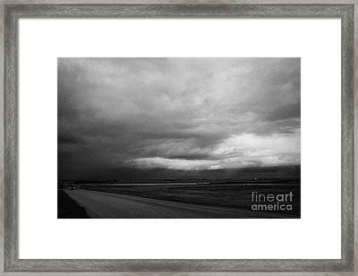 storm snow clouds forming over the prairies assiniboia Saskatchewan Canada Framed Print