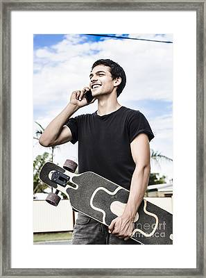 Student Talking To A Friend On Mobile Smartphone Framed Print by Jorgo Photography - Wall Art Gallery
