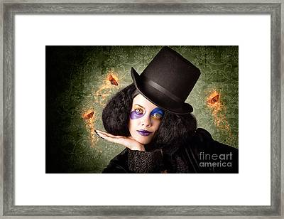 Stylish Female Magician Performing Magic Trick Framed Print by Jorgo Photography - Wall Art Gallery