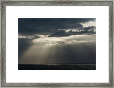 Sunlight Breaks Through The Clouds Framed Print