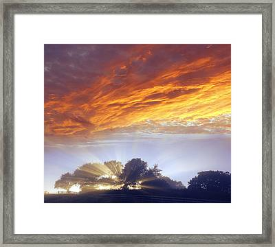 Sunrise Framed Print by Les Cunliffe