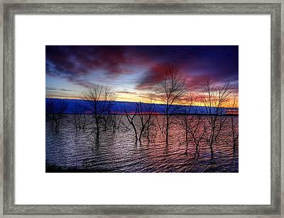 Sunrise On Devils Lake Framed Print by Larry Trupp