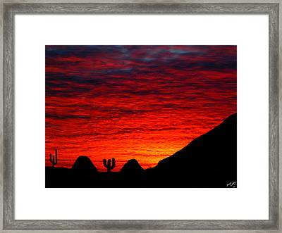 Sunset In The Desert Framed Print by Bruce Nutting