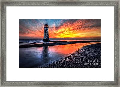 Sunset Lighthouse  Framed Print by Adrian Evans