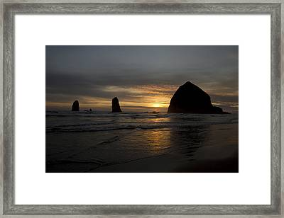 Sunset Over Haystack Rock In Cannon Beach Framed Print by David Gn