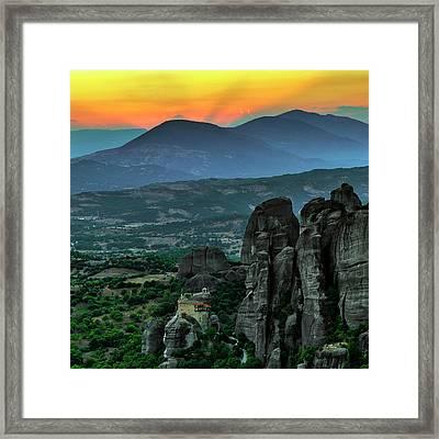 Sunset Over Meteora Framed Print by Babak Tafreshi