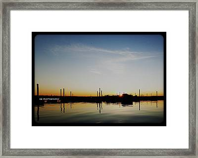 Sunset Over The Marina. Framed Print by Chris Babcock
