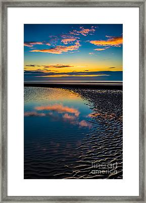 Sunset Reflections Framed Print by Adrian Evans