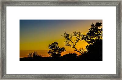 Sunset Silhouette Framed Print by Debra and Dave Vanderlaan