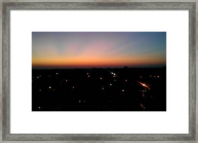 Sunset Silhouette Framed Print by Kenny Glover
