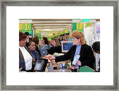 Supermarket Cashier Framed Print by Jim West