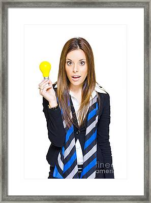 Surprised Business Woman With Lightbulb Solution Framed Print by Jorgo Photography - Wall Art Gallery