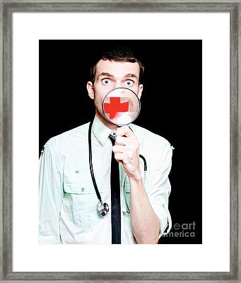 Surprised Doctor Showing Health Care Cross Framed Print