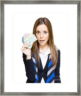 Surprised Young Business Woman Holding Fan Of Money Framed Print by Jorgo Photography - Wall Art Gallery