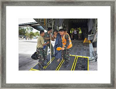 Survivors Of Super Typhoon Haiyan Framed Print by Jim Edds