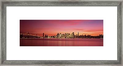 Suspension Bridge With City Skyline Framed Print