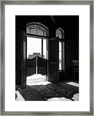 Swinging Doors Framed Print by Lucinda Walter