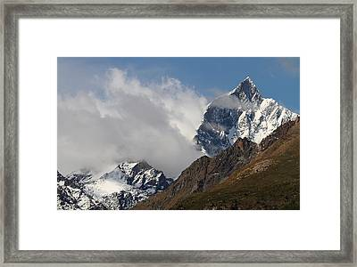 Swiss Alps Shrouded In Clouds Framed Print by Jetson Nguyen