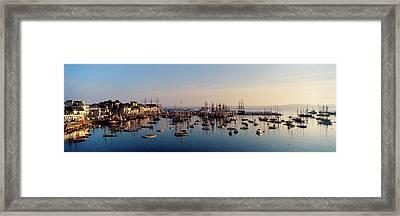 Tall Ships At A Harbor At Sunrise Framed Print