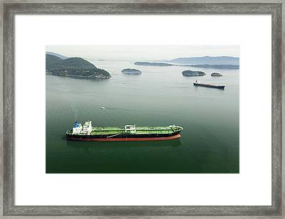Tanker Ships At Anchor Offshore Of The Framed Print by Andrew Buchanan/SLP