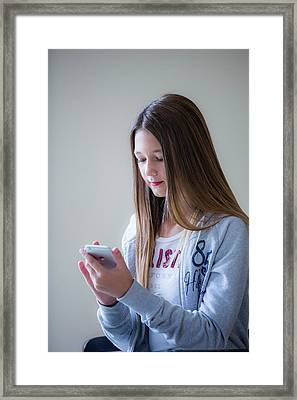 Teenage Girl Using Smartphone Framed Print by Samuel Ashfield