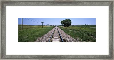 Telephone Poles Along A Railroad Track Framed Print