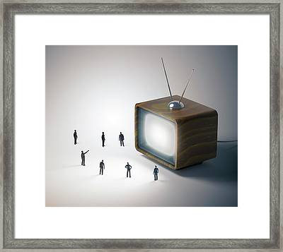 Television And Figures Framed Print