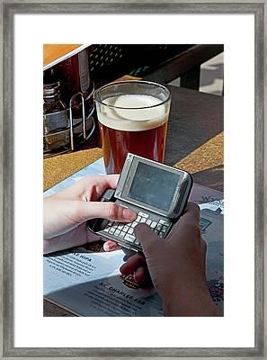 Texting At A Bar Framed Print