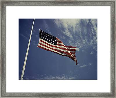 The American Flag Waving In The Wind Framed Print