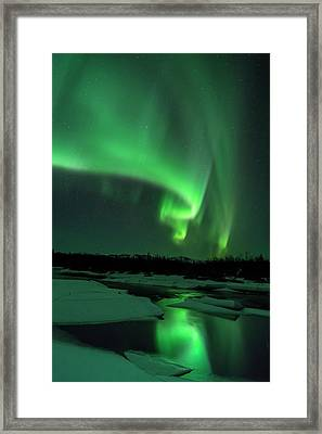 The Aurora Lights Up The Sky In Canada Framed Print by John Hyde