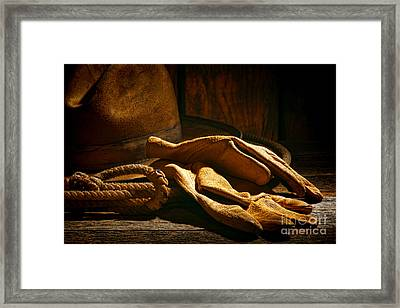 The Cowboy Gloves Framed Print by Olivier Le Queinec