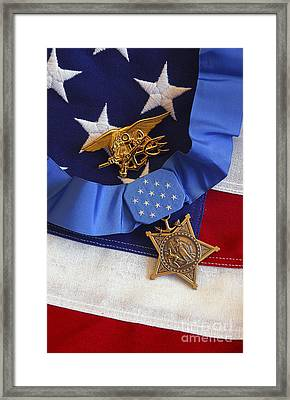 The Medal Of Honor Rests On A Flag Framed Print by Stocktrek Images