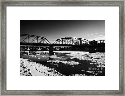 The Old Traffic And Broadway Bridges Over The South Saskatchewan River In Winter Flowing Through Dow Framed Print by Joe Fox