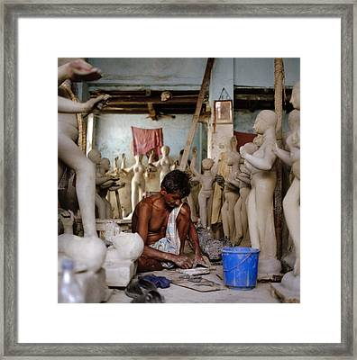 The Potter Framed Print by Shaun Higson