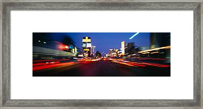 The Strip At Dusk, Las Vegas, Nevada Framed Print by Panoramic Images