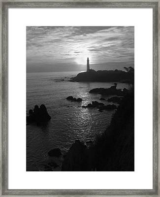 The Sun Is Setting Behind The Pigeon Point Light Station Near Ano Nuevo Framed Print