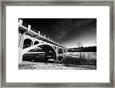 the university bridge over the freezing south saskatchewan river Saskatoon Canada Framed Print by Joe Fox