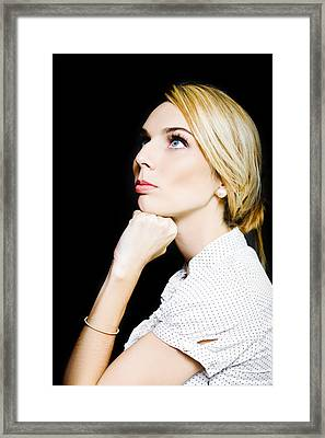 Thoughtful Businesswoman On Black Background Framed Print