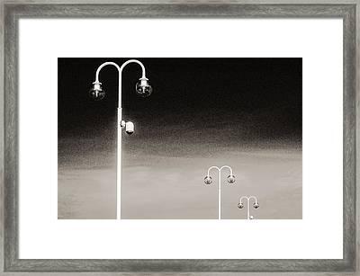 Three Framed Print by Arkady Kunysz