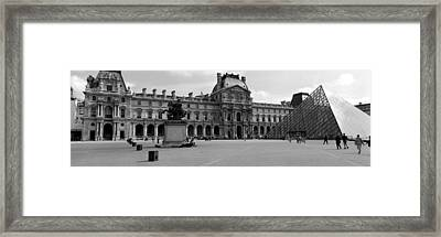 Tourists In The Courtyard Of A Museum Framed Print