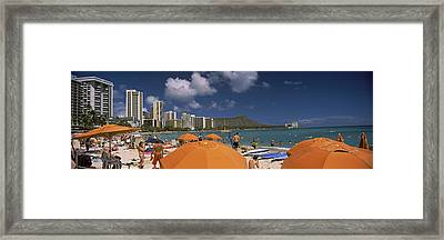Tourists On The Beach, Waikiki Beach Framed Print by Panoramic Images