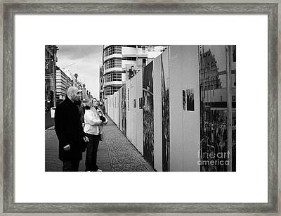 tourists read the history of the berlin wall at checkpoint charlie Berlin Germany Framed Print