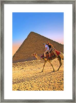 Tourists Ride A Camel In Front Framed Print by Miva Stock