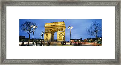 Tourists Walking In Front Framed Print